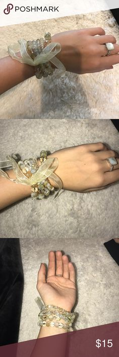 4 stackable bracelets- with removable ribbon. Never been worn- stackable bracelets. They have a clearish/cream tint! Jewelry Bracelets