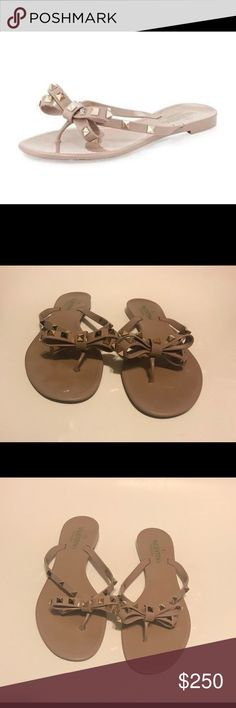 Valentino rockstud PVC thong sandals flip flops Golden pyramid studs punctuate a bow-topped flip-flop for a look that's part flirty, part fierce. Valentino Garavani PVC flip-flop with signature pyramid Rockstuds. Bow detail at thong strap. Stamped sole for traction. Flat heel. Made in Italy.  Size 40/10 ***Valentino's run small, most retailers recommend customer order .5 size larger than normal wear  Excellent condition, NO missing studs  No original box/ dust bag No trades  Price is FIRM…