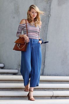 All deets: www.ohhcouture.com | Streetstyle: Chloé Faye bag, off the shoulder top, denim culottes, fringe heels #ohhcouture