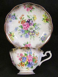 ROYAL ALBERT FLORAL SPRAY HEAVY GOLD FLUTED TEA CUP AND SAUCER