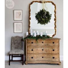 #HolidayDecorating Tip: Hang a festive #wreath on a mirror to create an instant #holiday look that's easily repeated throughout your home! {Photo: Donna Griffith, Design: Michael Penney}