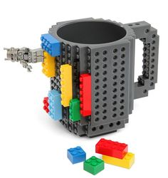 The Build-On Brick Mug is a coffee cup covered in studs and holes for attaching Lego and o...