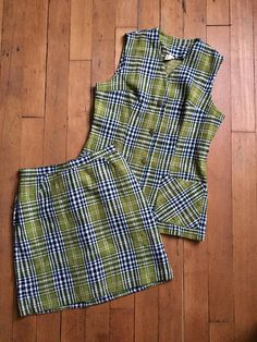 Wonderful late 1960s / early 1970s plaid skirt set. This set features a mini skirt and vest. Label: Queens-Way to Fashion