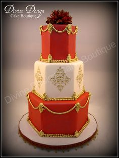 Hindu Inspired Wedding Cake - Red and white fondant. Details are fondant hand painted with gold highlighter. Damask was stenciled with royal icing then hand painted with gold.