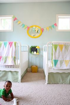 Cool Nursery Idea - Love the bright colors! Must find friend with twins to let me decorate.