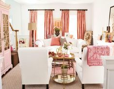 coral curtains with pink cabinet, lots of white and a touch of gold