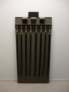 Hanging belt display I POP I Made from wood and metal I Belts hanging from hooks I www.sharndisplays.com