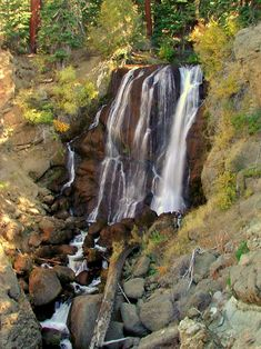 Thin ribbons of water drop a hundred feet onto rocks below Mill Creek Falls, Modoc National Forest
