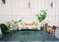 Tropical living room with teal rug, green plants, pillows, and armchair and coffee table Tropical Furniture, Tropical Home Decor, Tropical Houses, Tropical Interior, Estilo Tropical, Tropical Style, Modern Tropical, Cuban Decor, Living Room Decor