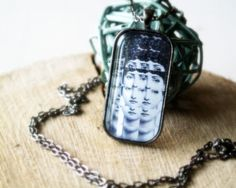 Magic mirror Fornasetti faces - Rectangular glass pendant necklace - Mixed Media - Altered art