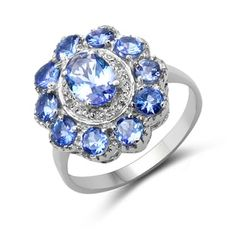 Shop for Malaika 1.74 Carat Genuine Tanzanite and White Diamond .925 Sterling Silver Ring. Get free delivery at Overstock.com - Your Online Jewelry Destination! Get 5% in rewards with Club O! - 18033734