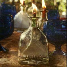 Oil lantern: 3/4 in. Diameter fiberglass wick, 1 1/2 in. Metal washer with half in. Opening, lamp oil, funnel, and empty Patron bottle.