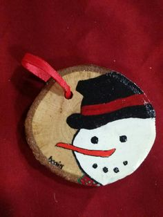 Wood slice ornament featuring a hand painted by JosLagniappe