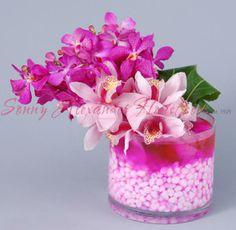 Sonny Alexander Flowers, beautiful orchid arrangement, pink flower arrangement, pink centerpiece, wedding, valentines day