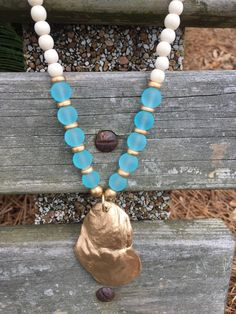 A personal favorite from my Etsy shop https://www.etsy.com/listing/533432880/ice-blue-sea-glass-beaded-necklace-with