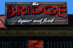 The Bridge, at California & Graham Streets in West Seattle, has a bit of a neighborhood sports bar atmosphere but it's not nearly as noisy. The food is excellent. Breakfast on weekends is great!