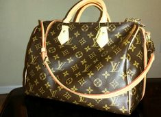 Ah I love this bag! Louis Vuitton Speedy Bandouliere 30 in Monogram
