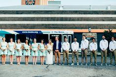 Wedding photography: Bridal party urban portrait with metro bus.