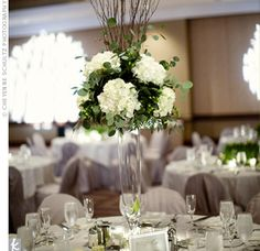 For pretty, modern centerpieces, clear trays were filled with wheatgrass and then cymbidium orchids were delicately placed among the blades.