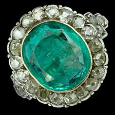A Century Rose Cut Diamond and Emerald Ring, the ring is set in gold and silver. The Collet set emerald is set between collet set diamonds and step set shoulders, UK size N. Cluster dimensions this is a fabulous statement ring, really wonderful. Antique Jewellery, Rose Cut Diamond, Statement Rings, 18k Gold, Turquoise Bracelet, Emerald, Antiques, Silver, Handmade