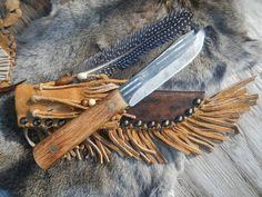 An old school mountain man style custom leather knife sheath for an old hickory butcher knife trade knife cow hide and buffalo split fringe. http://mrccustomleather.com