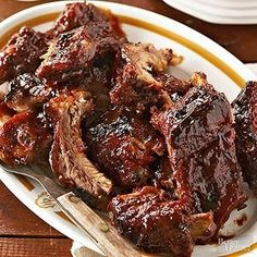 Ingredients 1 Rack of Pork Baby Back Ribs 12 oz. Coca-Cola 1/4 cup Brown Sugar 1 18 oz.Bottle of Barbecue Sauce Salt and Pepper to Taste Directions Spray the inside of the crock pot with non-stick spray or use a liner. Season the