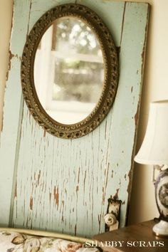 vintage mirror on an old salvaged door ... would be fun to add extra door knobs for hooks underneath