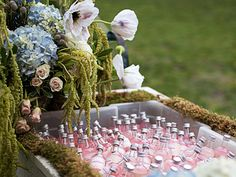 Wisteria Flowers and Gifts | Rustic Dream wedding floral arrangement and guest refreshments