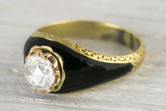 Erstwhile Jewelry Co. .72 Carat Antique Victorian Rose Cut Diamond & Black Enamel Engagement Ring, $4700, available at Erstwhile Jewelry Co..  Vintage Engagement Rings For The Unconventional Bride #refinery29  http://www.refinery29.com/vintage-engagement-ring-shopping#slide-11