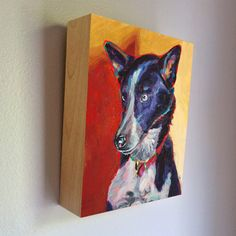 Small Saints exclusively designed custom acrylic painted portrait urn/keepsake vessel.  Your pet's portrait is painted upon it, and you put what you wish inside the compartment. It hangs on your wall just like portrait art should!