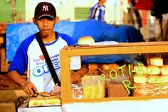 Indonesian Traditional Market: Baked Bread Seller.Location: Andir Traditional Market, Bandung, Indonesia