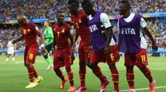 Asamoah Gyan of Ghana celebrates with his teammates