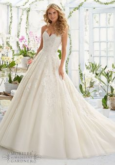 Wedding Dresses and Wedding Gowns by Morilee featuring Pearl and Crystal Beading on elegant Embroidery that decorates the classic Tulle ball gown Colors available:White Ivory Champagne.