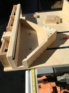Table saw crosscut sled with miter insert.                                                                                                                                                      More