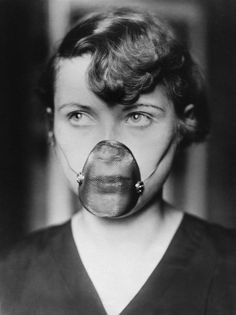 United States c. 1930. A woman wearing a new inhalation mask for treating catarrh of the nose and throat.