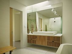 Love the warm color of the wood contrasting with the while.   mid-century modern bathrooms to soak your senses