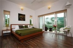 Suite room, Swiss County Munnar  -SAVIO and RUPA Interior Concepts Bangalore | professional interior design company Bangalore | Modern Interior Designers | Residential Interior Designs Residential Interior Design, Interior Design Companies, Modern Interior, Munnar, Interior Concept, Resorts, Designers, Bed, Room