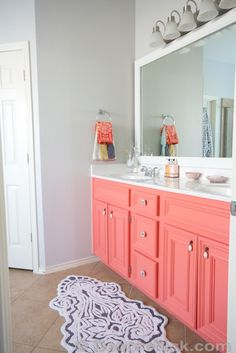 Paint Color-SW Agreeable Grey // Vanity Color-SW Coral Reef // Rugs, Towels  Hardware-Anthropologie //