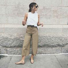 White sleeveless top on loose khaki pants