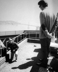 """Director Don Siegel frames a shot with Clint Eastwood for """"Dirty Harry"""""""