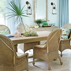 When the family needs to grab a quick bite to eat and doesn't feel like changing out of their swimsuits and flip-flops, they take a seat around the table in the breakfast room. Wicker chairs give the space a slightly more laid-back, casual feel than the neighboring dining room.  Get the Look: The curtain fabric is by Perennials. The chairs are from Mainly Baskets.