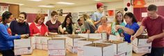 Owasso Mid-High and High School Future Community and Career Leaders of America (FCCLA) students spent Thursday boxing up care packages for soldiers deployed overseas.