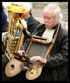 Washboard used as a musical instrument (the musician has thimbles on the ends of his fingers)(Charles Bridge, Prague, Czech Republic)