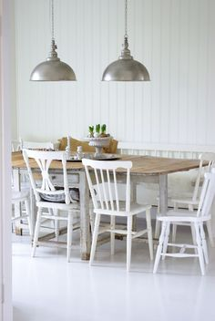 white kitchen, love the lamps...
