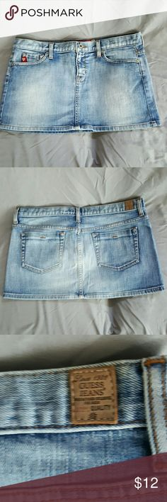 """Women's Guess Jean Skirt Like new, seldom worn, excellent condition, women's Guess Jean skirt (Stretch material).  99% COTTON; 1% SPANDEX.  Size 30 (7/8).  Measurements from top to bottom is 11 3/4"""". Guess Skirts Mini"""