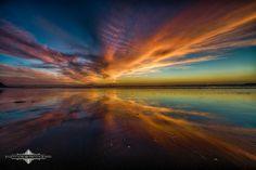 Ocean Beach Sunset by Evgeny Yorobe.