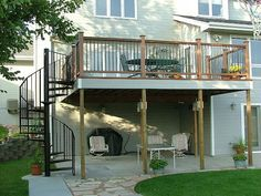 wooden deck with iron spiral staircase