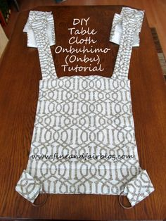 """Fine and Fair: DIY Tablecloth Onbuhimo Tutorial  FYI - 60"""" straps are long enough for most wearers to do the back carry with the tibetan finish.  If you want to bring the straps back around behind you to tie under bumyou may want to go a little longer, maybe 70-75""""?"""