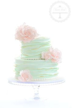 Such a beautiful cake in mint with pink vintage sugar roses and a hint of gold for a baby shower.