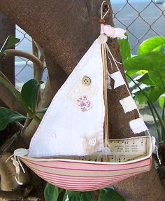 Small boat made from carding, paper and fabric using a pattern by Ann Wood Handmade. $60AUD